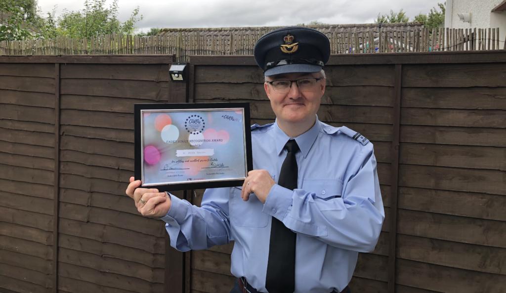 CARA winner Peter Brown holds his framed certificate