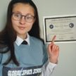 Cadet pointing to space school certificate