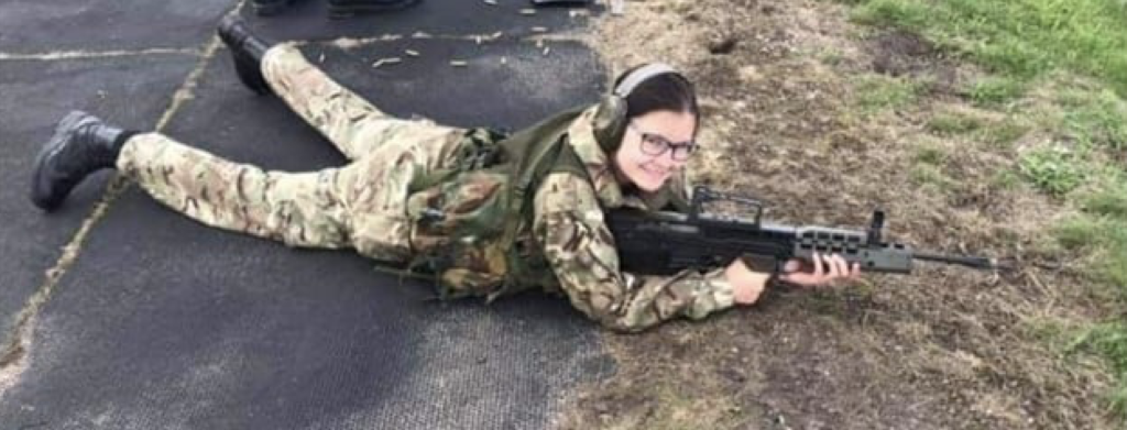 Cadet holding gun