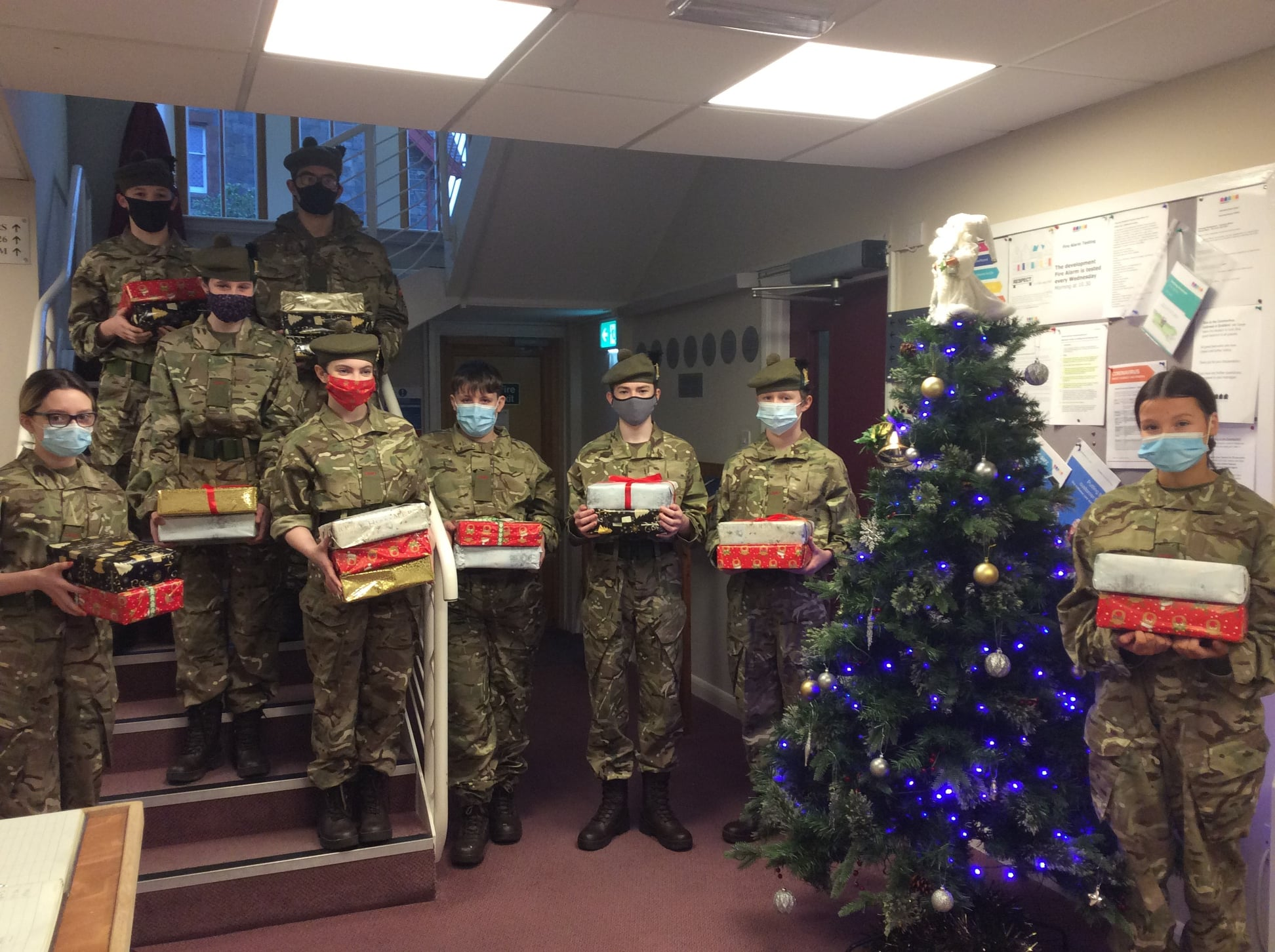 Cadets holding Christmas presents