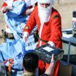 Father Christmas Distributes Presents to Soldiers
