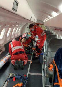 Paramedics at work on plane