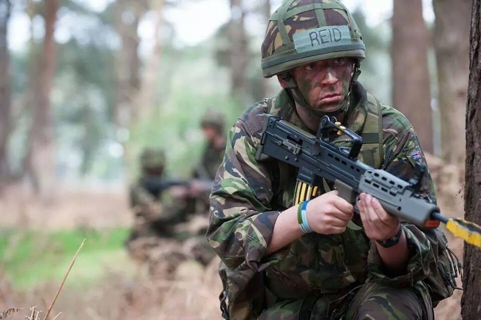 Air Cadet holding gun