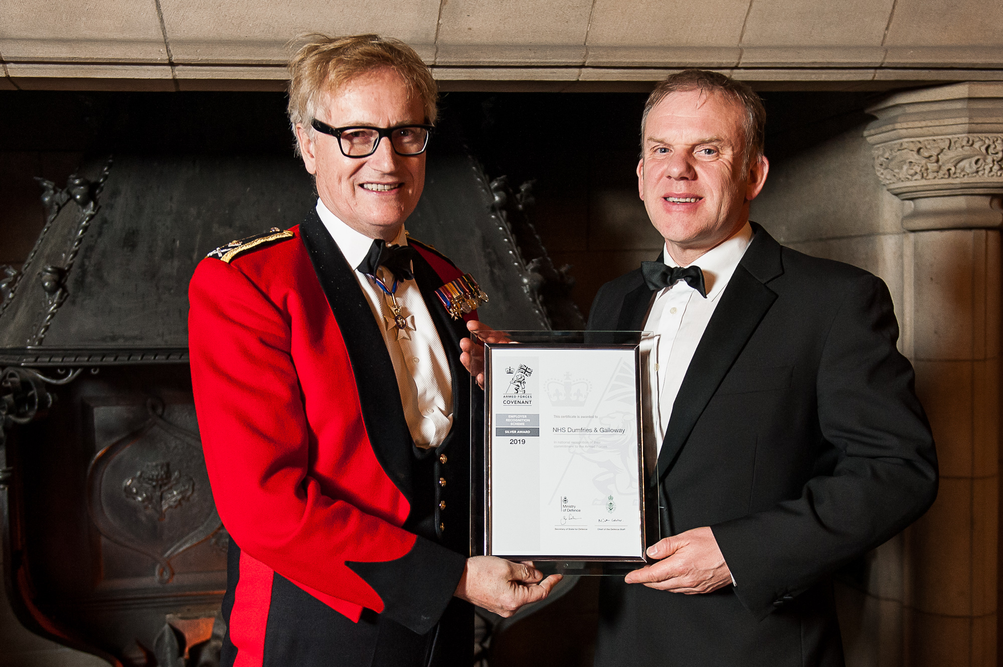 Two men holding a certificate