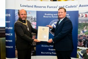 Lord Provost handing framed certificate to man in suit